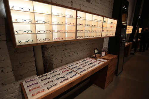 INSIDE OF THE SAN FRANCISCO STORE. GLASSES WITH MULTIPLE COLOR VARIATION ARE LINED UP